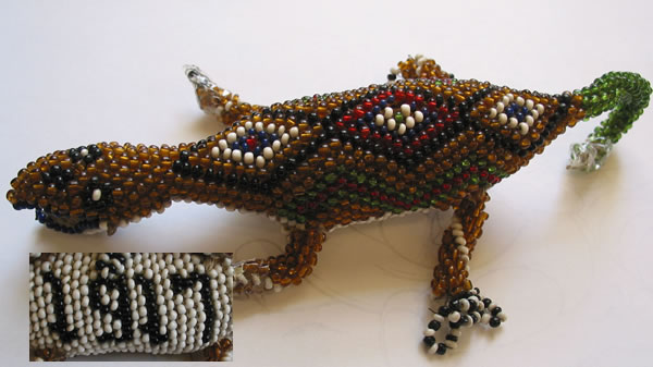 This beaded lizard made at Knockaloe in 1917 was recently donated to the museum by Diana Gibbs from West Sussex on the occasion of her wedding on the Island.