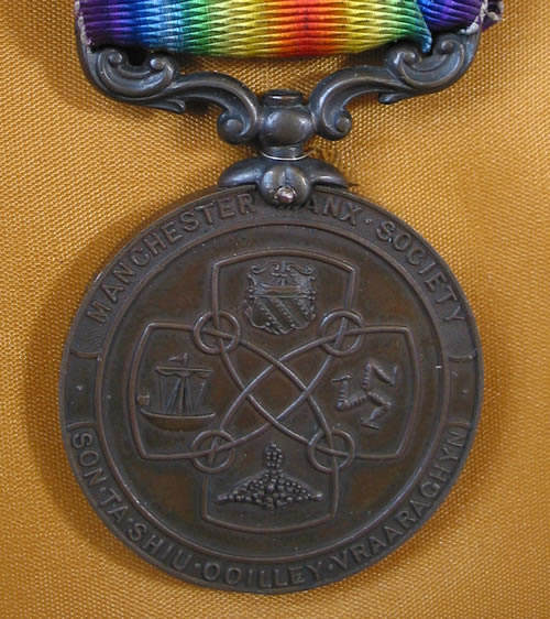 Harry Costain's medal. Loaned by Garry and Melvyn Reid, grandsons of Harry Costain.