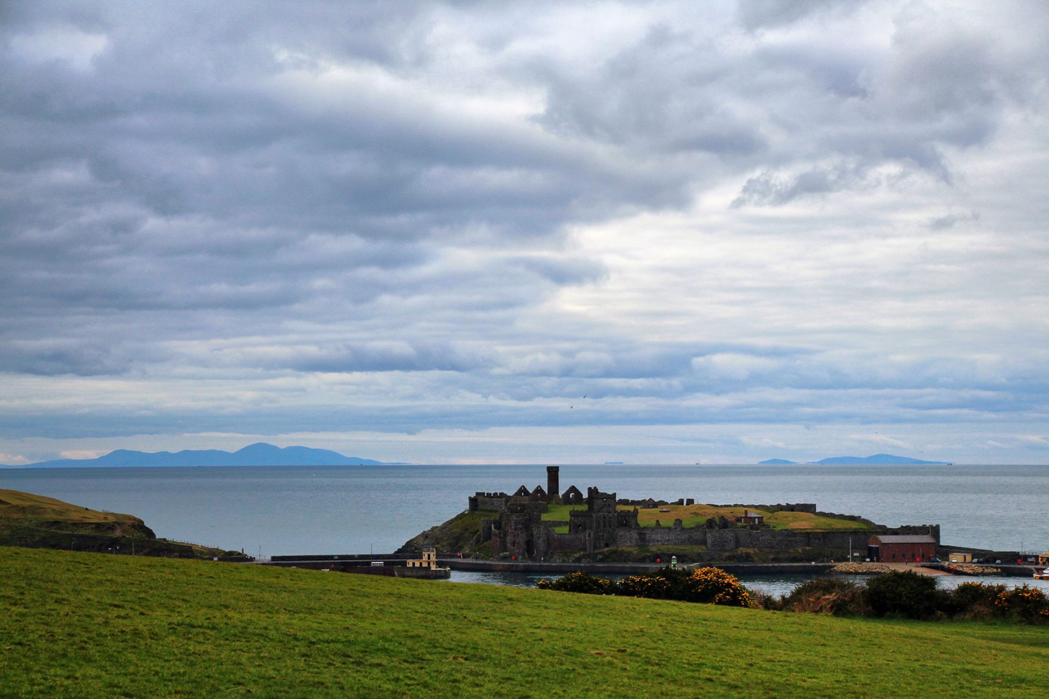 Peel Castle and the Irish hills, by Dave Corkish
