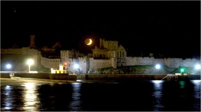 Last of the moon over the castle, by Dave Corkish