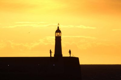 Lighthouse at sunset, by Dave Corkish