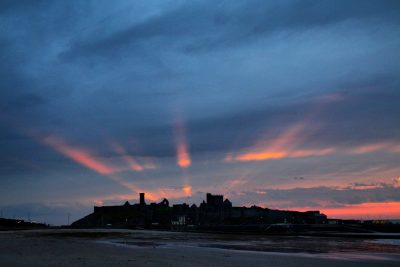 Sun rays over the castle, by Dave Corkish