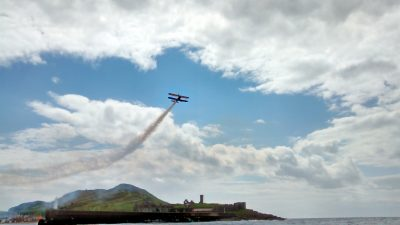 Peel Day wing walking display, by Jill Evans from yacht Kondor while taking part in a PSCC race on Peel Day.